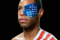 Man with US flag painted on face and shoulder