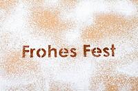 Happy Holidays logo in cocoa powder