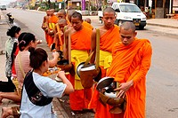 Morning round of buddhist monks begging for alms or Tak Bat, Luang Prabang, UNESCO World Heritage Site, Laos