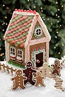 Gingerbread men cookies and gingerbread house