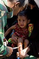 A girl being treated for a wound at an army medical camp in Rainda, Shoronkhola Bagerhat, Bangladesh November 20, 2007