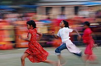 Children racing at a sports festival in Mujgunni, Khulna, Bangladesh December 22, 2007