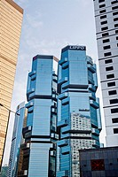 China, Hong Kong, Admiralty highrise, the Lippo Twin Towers sandwiched between the Far East Finance Centre and the Bank of America Tower