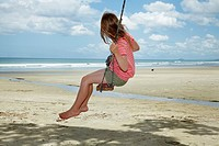 Young Girl on Rope Swing under Pohutukawa Tree, Waihi Beach, Coromandel, North Island, New Zealand