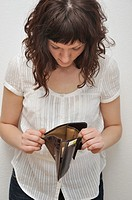 Woman looking at empty wallet