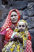 A woman and daughter with a naturlichen mask in the city of Mutsamudu on the Comoro Archipelago island Anjouan before the African coast in the Indian ...