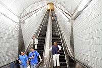 Georgia, Atlanta, MARTA, Peachtree Center Station, rapid transit, underground, escalator, down, up, ascend, descend, tile, woman, man, perspective, le...