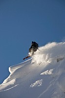 A male freeskier backcountry skiing in Roger´s Pass, Glacier National Park, British Columbia, Canada