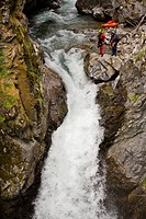 Two kayakers scope a line on Sand Creek, Galloway, British Columbia, Canada