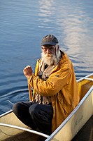 Older man canoeing during a multi week trip in Wabakimi Provincial Park, Ontario, Canada