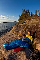 A young man camping for 2 weeks in Wabakimi Provincial Park, Northern Ontario, Canada