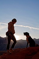 A female climber and her friendly dog, Red Rocks, Nevada, United States of America