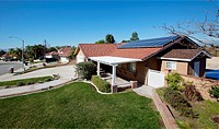 Roof solar panels on a neighborhood home in Riverside, California, USA