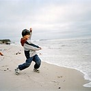 A Boy Playing on a Beach.