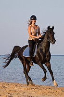 woman riding on Arabian horse