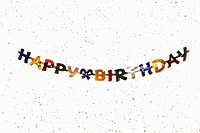 A hanging banner spelling HAPPY BIRTHDAY with confetti