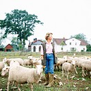 Woman with a flock of sheep, Sweden.