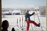 A skier outside a window, Sweden.