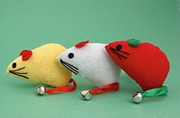 Three different colored cat toy mice