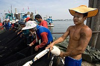 urmese migrants working as fishermen at a port in Samut Songkram Thailand October, 2007