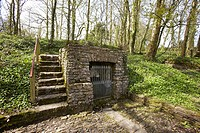 Salmons Well, a group of three wells near Penllyn in the Vale of Glamorgan, South Wales, UK with the inscription 'Dwr Rhudd Yr Hollalluog Dduw' Water,...
