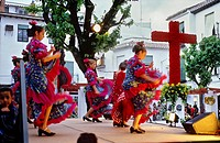Dia de la Cruz, floral cross and dancers, in Plaza Larga,Albaicin quarter, Granada, Andalucia, Spain