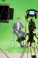 Presenter in TV studio with green screen