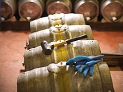 Barrels and hammer in brewery