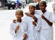 muslim boys eating ice cream on their way to the muslim school, mae sot , northern thailand