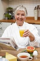 An elderly woman having breakfast, Sweden.