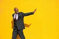 African American businessman waving