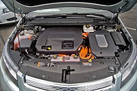 The engine compartment of a Chevrolet Volt hybrid gas/electric car  Right side: the power inverter in top of the electric motor  Left side: the 1 4-li...