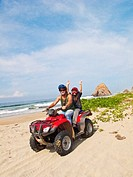 man and girl riding dune buggy