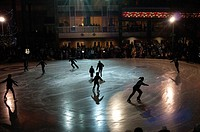 Ice skaters perform for the public on New Year´s Eve in Town Square Park, downtown Anchorage, Southcentral Alaska, Winter