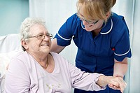 Geriatric care. Nurse assisting a patient.