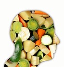 Vegetarianism, conceptual image. Various vegetables inside a human head, representing a diet consisting solely of plant_based foods, such as fruit, ve...