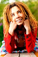 Portrait of charming girl with dreadlocks