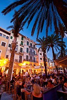 People In Cafes And Restaurants In Square With Palm Trees In The Evening,, Palma, Majorca, Spain
