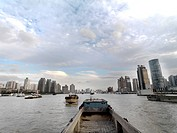 Barges going up and down the Huangpu River through Pudong, Shanghai.