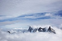 mountain peaks above the clouds, chamonix, france