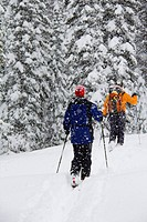 Couple backcountry skiing in snowstorm