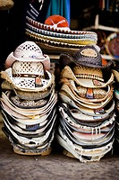 Straw hats in piles