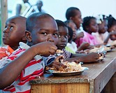 children eating a hot meal, port_au_prince, haiti