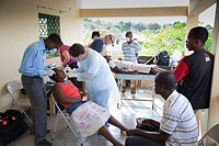 dentists volunteer their dentistry to help haitian people who are living in poverty, grand saline, haiti