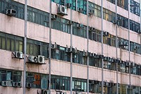 Older block of small tightly packed apartments in Hong Kong