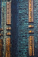 Reflections in the mirrored surface of a skyscraper