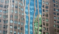 Distorted reflection in a mirrored skyscraper