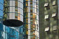 Detail of two adjacent mirrored skyscrapers