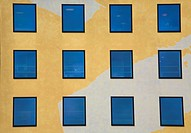 Reflective windows in a yellow building