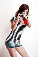 Fashiuon woman with a camera